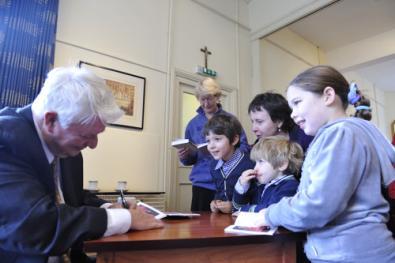 deacon_sullivan_signing_books.jpg