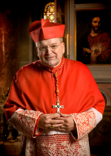 LISA JOHNSTON | lisa@aeternus.com  lisajohnston@archstl.org .His Eminence Raymond Cardinal Leo Burke | Prefect of the Apostolic Signatura | Archbishop Emeritus of St. Louis in front of the shrine to the Sacred Heart of Jesus in the Cathedral Basilica of S
